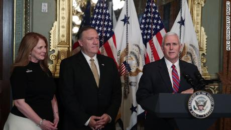 U.S. Vice President Mike Pence (R) speaks as Mike Pompeo (2nd L) and wife Susan Pompeo (L) look on during a swearing in ceremony for Pompeo to become CIA Director in January 2017