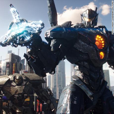 "(L to R, foreground) Jaeger mechs ""Saber Athena,"" ""Bracer Phoenix,"" ""Gipsy Avenger"" and ""Guardian Bravo"" in ""Pacific Rim Uprising.""  The globe-spanning conflict between otherworldly monsters of mass destruction and the human-piloted super-machines built to vanquish them was only a prelude to the all-out assault on humanity."