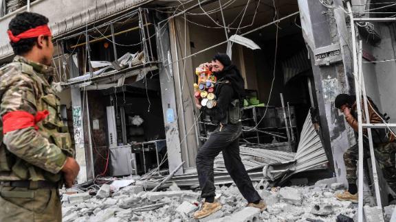 Rebels loot shops in Afrin.