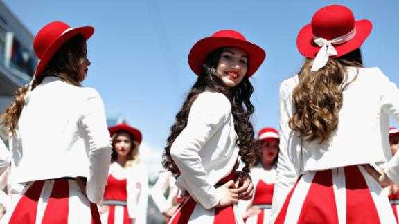 """Grid girls are paid """"well above"""" the UK minimum wage, James says."""