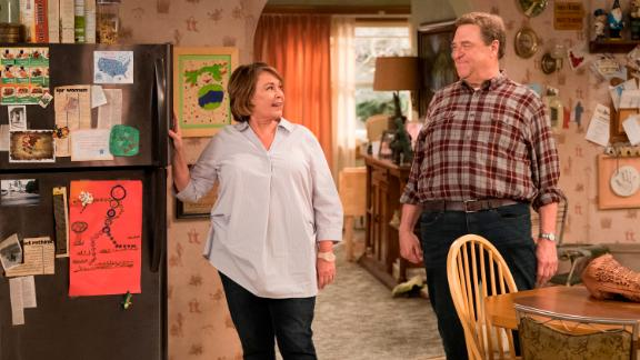 "ROSEANNE - ""Roseanne Gets the Chair"" - Roseanne's clash with Darlene over how she's raising her kids - especially Harris - reaches a breaking point; while Dan tries to help Roseanne with her bad knee by getting her an elevator chair, which she refuses to use because she doesn't want to admit getting old, on the second episode of the revival of ""Roseanne,"" TUESDAY, APRIL 3 (8:00-8:30 p.m. EDT), on The ABC Television Network. (ABC/Adam Rose)