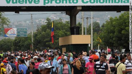 Venezuelan citizens cross the Simon Bolivar international bridge from San Antonio del Tachira in Venezuela to Norte de Santander province of Colombia on February 10, 2018. Oil-rich and once one of the wealthiest countries in Latin America, Venezuela now faces economic collapse and widespread popular protest.  / AFP PHOTO / GEORGE CASTELLANOS        (Photo credit should read GEORGE CASTELLANOS/AFP/Getty Images)
