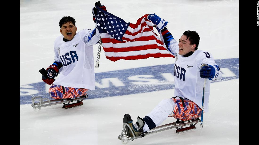 Ralph DeQuebec, left, and Jack Wallace celebrate after the US sled hockey team won gold at the Winter Paralympics on Sunday, March 18.