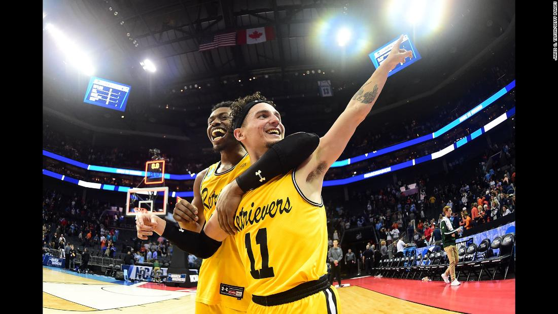 "K.J. Maura points to the crowd as he and teammate Jourdan Grant celebrate UMBC's <a href=""http://bleacherreport.com/articles/2765003-umbc-shocks-virginia-in-1st-1-vs-16-seed-upset-in-ncaa-tournament-history"" target=""_blank"">shocking upset of Virginia</a> on Friday, March 16. It was the first time in history that a No. 16 seed defeated a No. 1 seed at the NCAA Tournament, and UMBC — which stands for the University of Maryland, Baltimore County — did it in style. The Retrievers blew out Virginia 74-54. No. 1 seeds had been 135-0 going back to 1985."