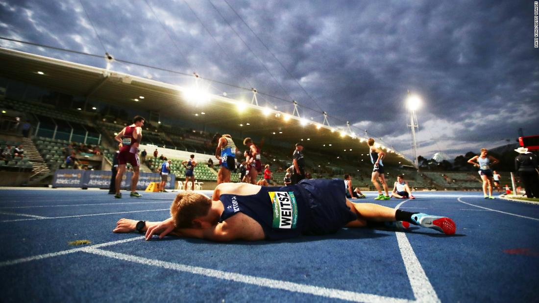 Robert Weitsz rests on a track in Sydney after running the 2,000-meter steeplechase at the Australian Junior Championships on Wednesday, March 14.