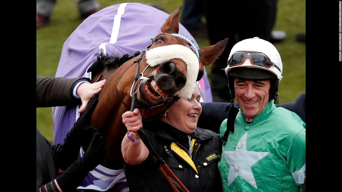 Jockey Davy Russell celebrates after he rode Presenting Percy to victory at the Cheltenham Festival in England on Wednesday, March 14.