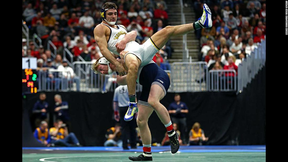 Penn State wrestler Bo Nickal, bottom, competes against Michigan's Domenic Abounader during the NCAA Championships on Friday, March 16. Nickal went on to win his second straight title in his weight class, and Penn State won its seventh national title in eight years.