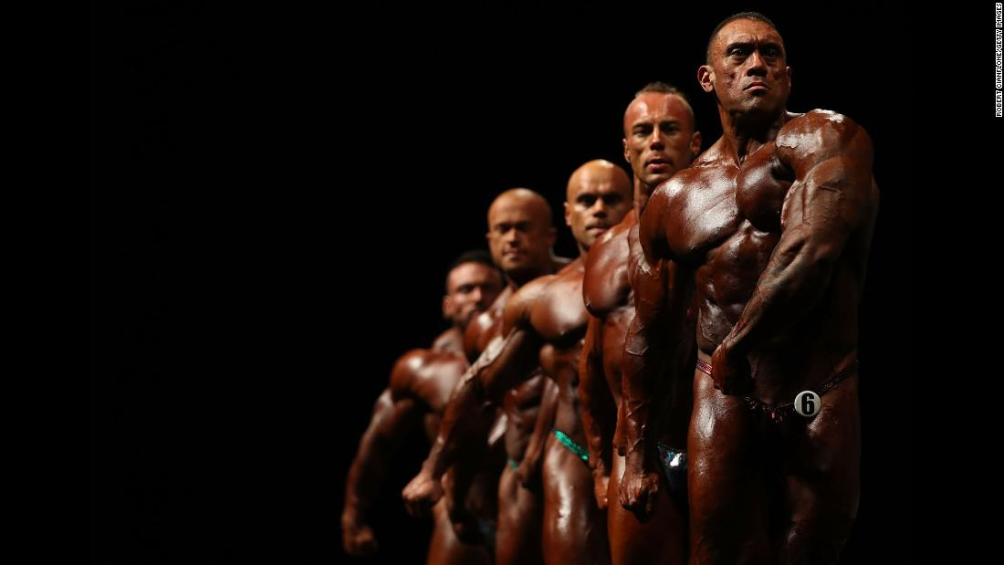 Bodybuilders pose in Melbourne during the Arnold Classic Pro Show on Saturday, March 17.