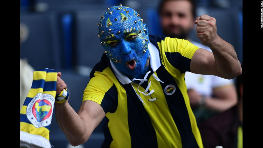 A fan of the Turkish soccer club Fenerbache shows his support before a league game against Galatasaray on Saturday, March 17.