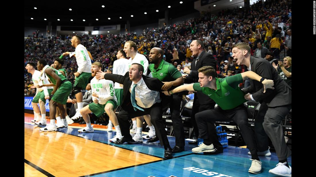People react on Marshall's bench during the school's first-round NCAA Tournament game on Friday, March 16. The Thundering Herd, a 13 seed, upset fourth-seeded Wichita State 81-75. It was Marshall's first-ever win in the NCAA Tournament.