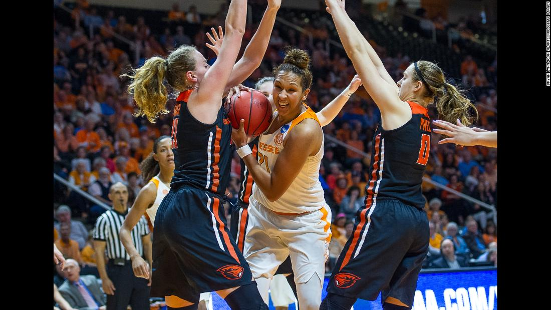 Tennessee center Mercedes Russell, center, is guarded by Oregon State players during an NCAA Tournament game on Sunday, March 18. Oregon State upset Tennessee 66-59 to advance to the Sweet Sixteen.