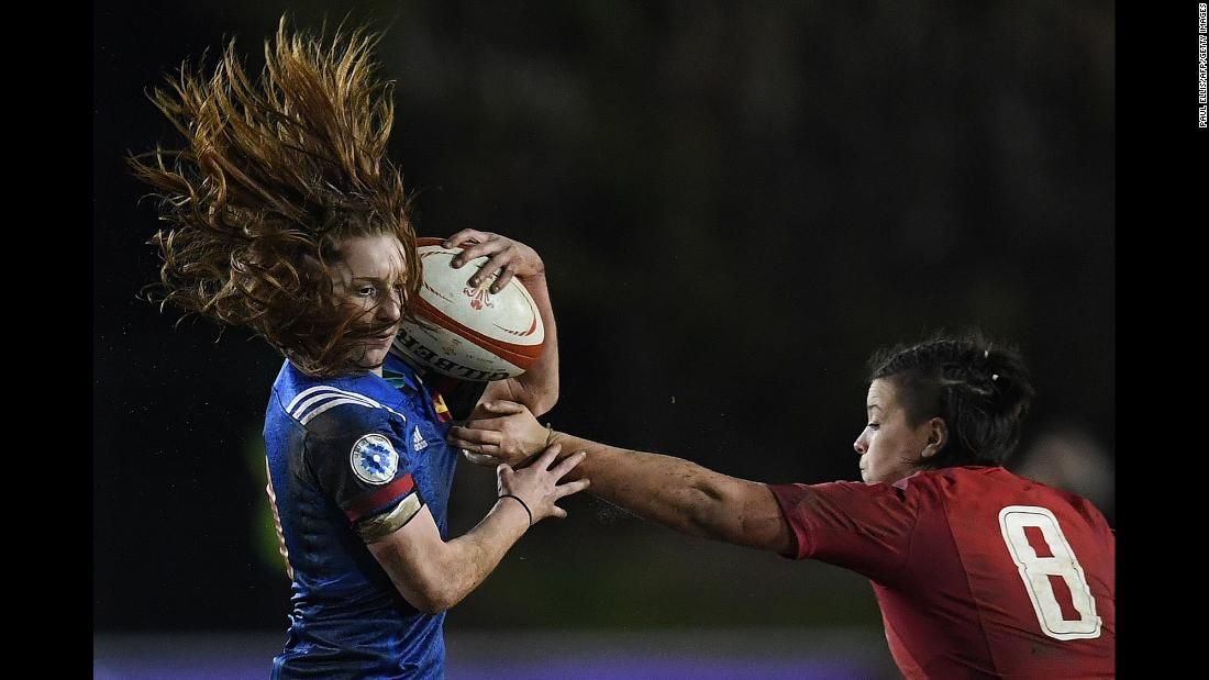 France's Pauline Bourdon evades a tackle by Wales' Sioned Harries during a Six Nations rugby match in Colwyn Bay, Wales, on Friday, March 16. France won 38-3 to clinch its second title in three years.