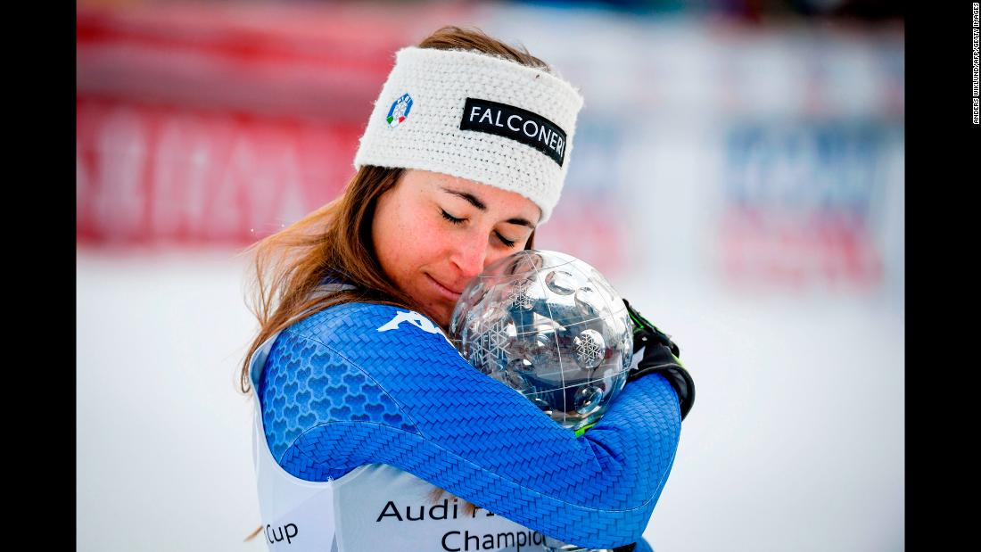 Italian skier Sofia Goggia embraces the World Cup trophy she received for the downhill title on Wednesday, March 14. Goggia also won Olympic gold in the downhill last month.