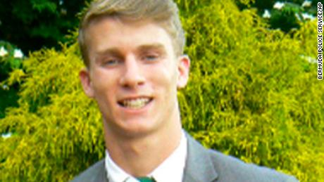 This undated photo released by the Bermuda Police Service shows American college student Mark Dombroski, who has been reported missing in Bermuda. Bermuda police Dombroski was on a rugby tour with Saint Joseph's University, a college near Philadelphia, when he disappeared early Sunday, March 18, 2018. (Courtesy of Bermuda Police Service via AP)