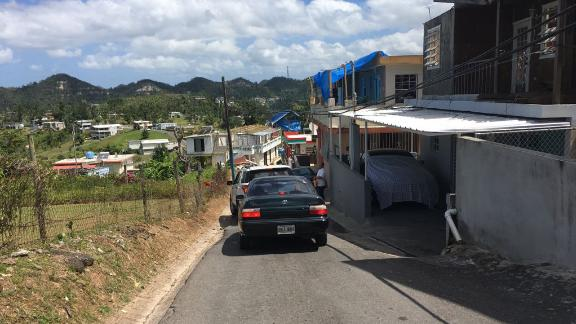 Blue tarps are still the only roofs for some homes in Corozal.