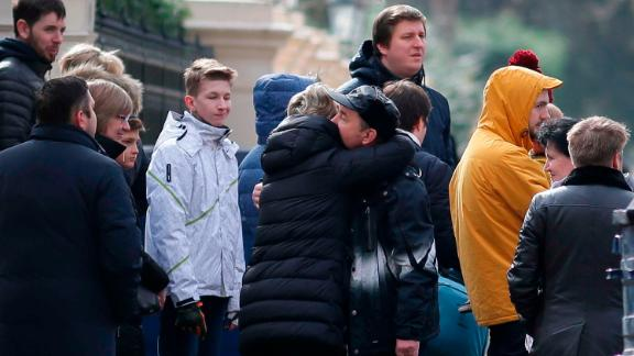 People hug last week at the Russian Embassy in London after the UK