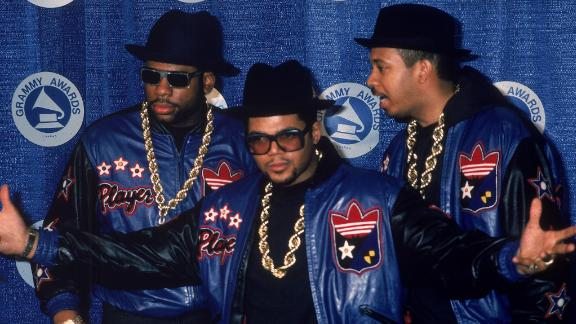 """Run-DMC members Jam Master Jay (Jason Mizell), Joe """"Run"""" Simmons and Darryl """"DMC"""" McDaniels pose at the Grammy Awards in the 1980s."""