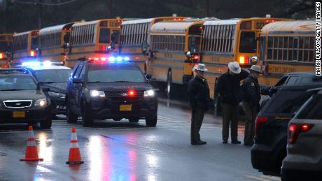 GREAT MILLS, MD - MARCH 20: School buses are lined up in front of Great Mills High School after a shooting on March 20, 2018 in Great Mills, Maryland.  It was reported that  two students at a Maryland high school were injured after a colleague opened fire in the hallway just before classes began. (Photo by Mark Wilson/Getty Images)