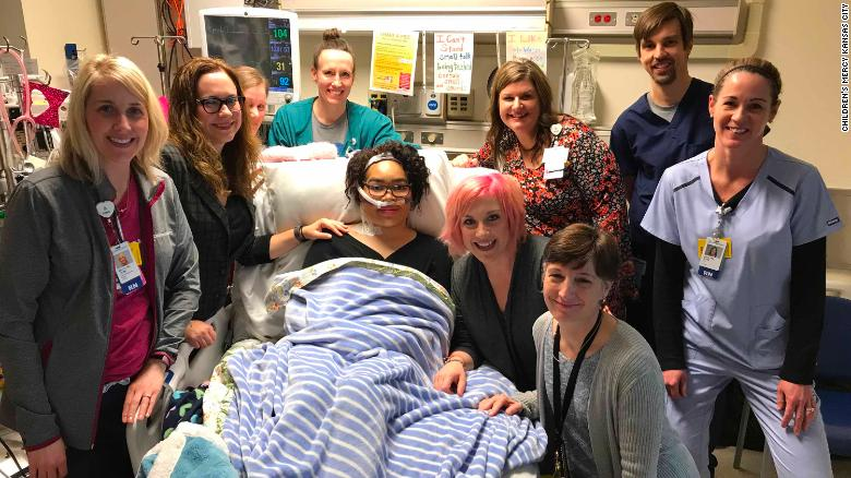Zei Uwadia, center, with her mother and medical team at Children's Mercy Kansas City. Clockwise from left: Kari Davidson, Dr. Jenna Miller, Ryanne Toland, Julie Pearson, Debbie Newton, Dr. Jay Rilinger, Jill Dinkel, Dr. Marita Thompson and Zei's mother, Brie Kerschen.