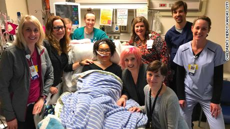 Zei Uwadia (middle) with her mother and medical team at Children's Mercy Kansas City. Clockwise, from left, are Kari Davidson, Dr. Jenna Miller, Ryanne Toland, Julie Pearson, Debbie Newton, Dr. Jay Rilinger, Jill Dinkel, Dr. Marita Thompson, and Zei's mother Brie Kerschen.