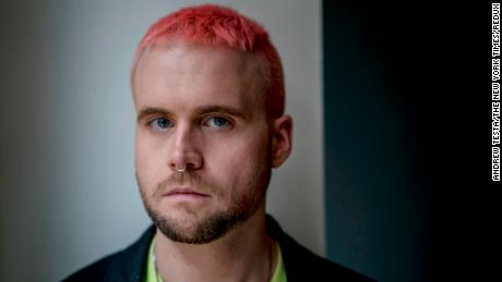 "Christopher Wylie, who helped found the data firm Cambridge Analytica and worked there until 2014, in London, March 12, 2018. Cambridge Analytica harvested personal information from a huge swath of the electorate to develop techniques that were later used in the Trump campaign. ""Rules don't matter for them,"" Wylie said of the company's leaders. ""For them, this is a war, and it's all fair."" (Andrew Testa/The New York Times)"