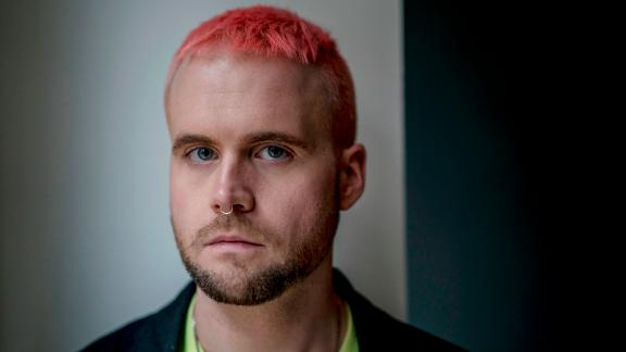 """Christopher Wylie, who helped found the data firm Cambridge Analytica and worked there until 2014, in London, March 12, 2018. Cambridge Analytica harvested personal information from a huge swath of the electorate to develop techniques that were later used in the Trump campaign. """"Rules don't matter for them,"""" Wylie said of the company's leaders. """"For them, this is a war, and it's all fair."""" (Andrew Testa/The New York Times)"""
