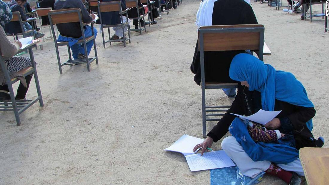 Inspiring photo of Afghan woman taking university exam while nursing child goes viral