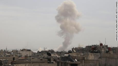 Smoke billows following Syrian government air strikes on the Eastern Ghouta rebel-held enclave of Douma, on the outskirts of the capital Damascus on March 20, 2018. Syrian regime and allied forces battled to suppress the last pockets of resistance in and around Damascus while the beleaguered Kurds in the north braced for further Turkish advances. Assad has in recent months brought swathes of territory back under his control thanks to heavy Russian involvement, as well as support from other forces such as the Iran-backed Lebanese Hezbollah militia. Eastern Ghouta's main town of Douma remains under rebel control but even as a trickle of emergency medical evacuations was scheduled to continue, the regime continued to pound the enclave. / AFP PHOTO / HAMZA AL-AJWEH        (Photo credit should read HAMZA AL-AJWEH/AFP/Getty Images)