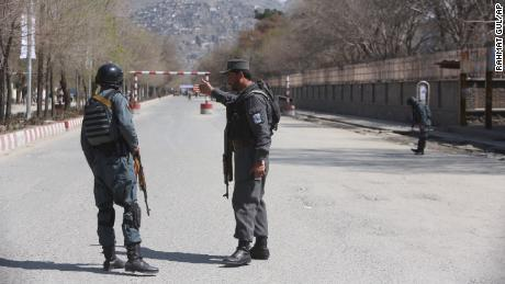 Police patrol the streets after a blast in front of Kabul University on Wednesday.