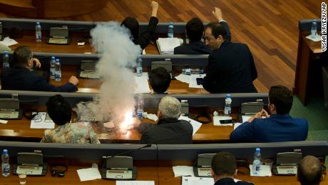 Opposition lawmakers ignite a tear gas canister, disrupting a parliamentary session in Pristina on Wednesday.