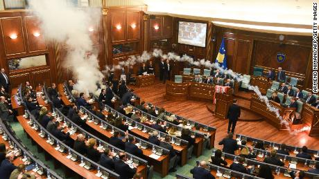 Kosovo's opposition lawmakers release a teargas canister inside the country's parliament in Pristina on Wednesday.