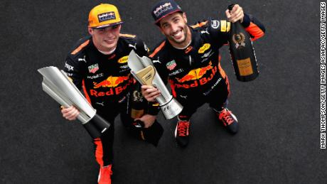 KUALA LUMPUR, MALAYSIA - OCTOBER 01:  Race winner Max Verstappen of Netherlands and Red Bull Racing celebrates with third place finisher Daniel Ricciardo of Australia and Red Bull Racing on the podium during the Malaysia Formula One Grand Prix at Sepang Circuit on October 1, 2017 in Kuala Lumpur, Malaysia.  (Photo by Mark Thompson/Getty Images)