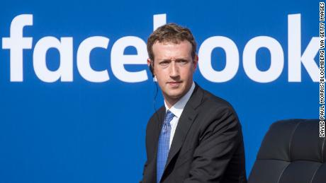 "Mark Zuckerberg, chief executive officer of Facebook Inc., listens as Narendra Modi, India's prime minister, not pictured, speaks during a town hall meeting at Facebook headquarters in Menlo Park, California, U.S., on Sunday, Sept. 27, 2015. Prime Minister Modi plans on connecting 600,000 villages across India using fiber optic cable as part of his ""dream"" to expand the world's largest democracy's economy to $20 trillion. Photographer: David Paul Morris/Bloomberg via Getty Images"