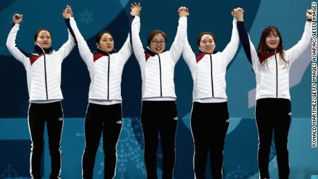 The Garlic Girls celebrate an historic silver medal on the Winter Olympic podium in Pyeongchang
