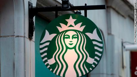 A logo is pictured on a sign outside a Starbucks coffee shop in London on November 15, 2017.   / AFP PHOTO / Justin TALLIS        (Photo credit should read JUSTIN TALLIS/AFP/Getty Images)