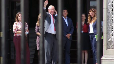 Peruvian former President Pedro Pablo Kuczynski (C), waves before leaving the Palace of Government in Lima, after recording a televised message in which he announced his resignation on March 21, 2018.  President Pedro Pablo Kuczynski of Peru announced his resignation Wednesday in an address to the nation, the day before he was to face an impeachment vote in Congress.  / AFP PHOTO / LUKA GONZALES        (Photo credit should read LUKA GONZALES/AFP/Getty Images)