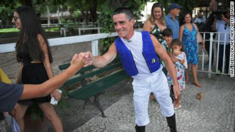 Brazilian jockey Jorge Ricardo greets well-wishers at Rio de Janeiro's Hipodromo race track in Rio de Janeiro, Brazil on February 4, 2018.   Ricardo rode his 12,844th win at Rio de Janeiro's Hipodromo race track on February 5, 2018 equalling the extraordinary world record held by his career-long Canadian rival Russell Baze. The two jockeys have racked up more wins than any other jockey in the world and for years they traded places in the number one spot.  / AFP PHOTO / CARL DE SOUZA        (Photo credit should read CARL DE SOUZA/AFP/Getty Images)