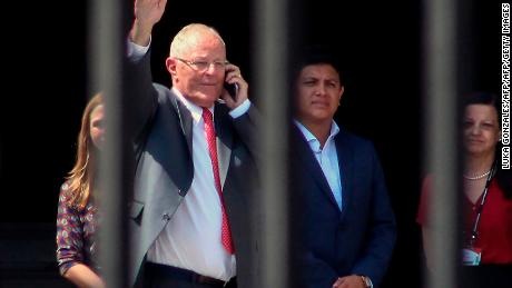 Peruvian former President Pedro Pablo Kuczynski (L), waves before leaving the Palace of Government in Lima, after recording a televised message in which he announced his resignation on March 21, 2018.  President Pedro Pablo Kuczynski of Peru announced his resignation Wednesday in an address to the nation, the day before he was to face an impeachment vote in Congress.  / AFP PHOTO / LUKA GONZALES        (Photo credit should read LUKA GONZALES/AFP/Getty Images)
