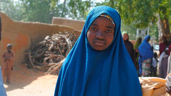 Aishat Alhaji , one of the kidnapped girls from the Government Girls Science and Technical College Dapchi who was freed, is photographed after her release,  in Dapchi, Nigeria, Wednesday March. 21, 2018. Witnesses say Boko Haram militants have returned an unknown number of the 110 girls who were abducted from their Nigeria school a month ago. (AP Photo/Jossy Ola)