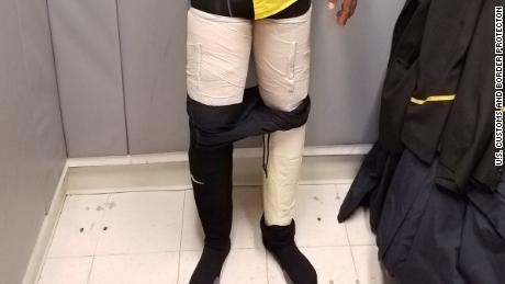 Photo from U.S. Customs and Border Protection shows nine pounds of cocaine taped to suspect's leg