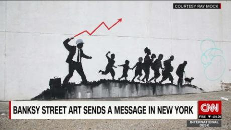 exp Banksy street art sends a message in NYC_00002001.jpg