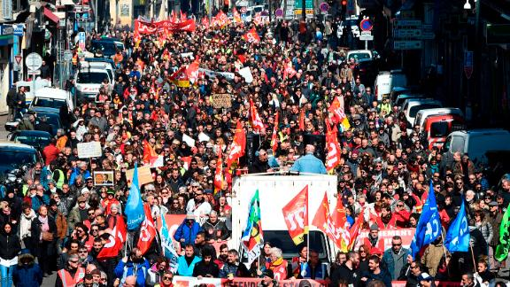 People hold CGT union flags as they take part in a demonstration to protest against French government's string of reforms, on March 22, 2018 in Marseille, southern France. Seven trade unions have called on public sector workers to strike on March 22, including school and hospital staff, civil servants and air traffic controllers. More than 140 protests are planned across France, the biggest culminating at the Bastille monument in Paris where unions expect 25,000 demonstrators.  / AFP PHOTO / Boris HORVAT        (Photo credit should read BORIS HORVAT/AFP/Getty Images)