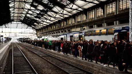 People disembark from a Paris suburban train at the Gare de Lyon railway station on Thursday.