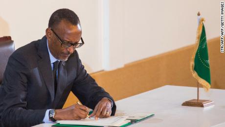 Rwanda's President Paul Kagame signs an agreement for establishing the African Continental Free Trade Area.