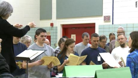 "Prisoners at the Oakdale Prison in Iowa and community volunteers practice singing Beethoven's ""Prisoners Song."""