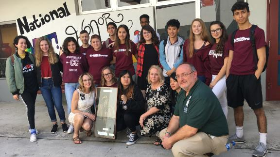 Joanne Avery, front row at left, presented the dreamcatcher to Marjory Stoneman Douglas High School. They only accepted it for 17 seconds.