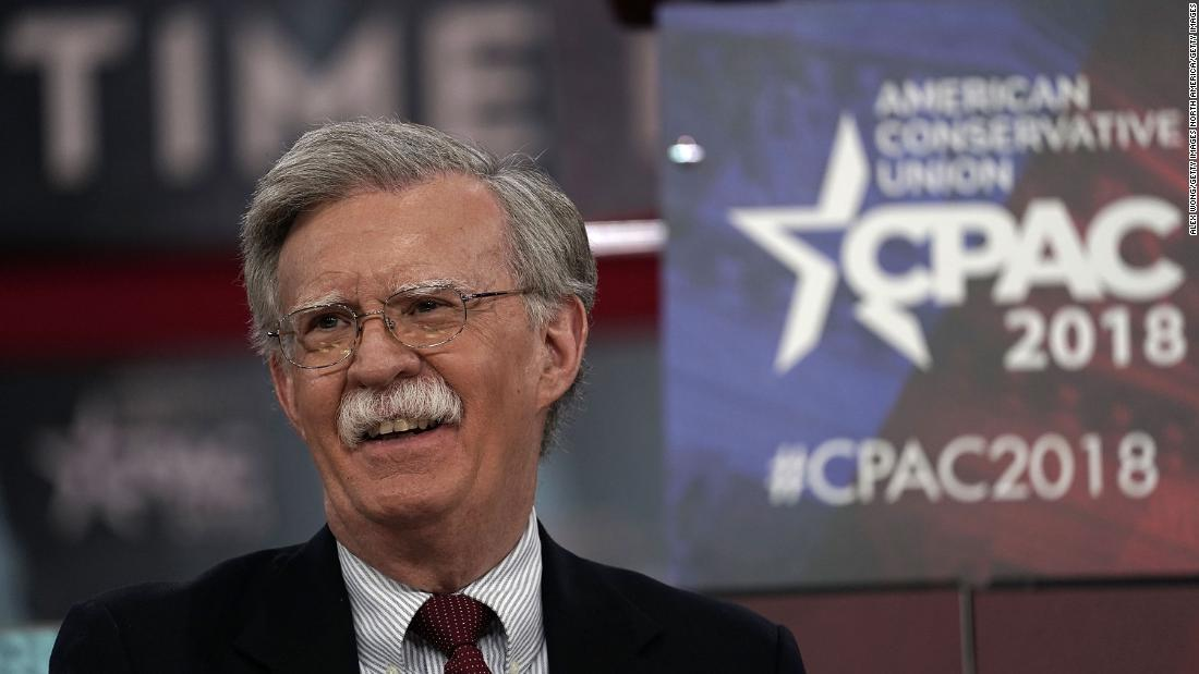 World wary as Trump turns to hardliners Bolton and Pompeo