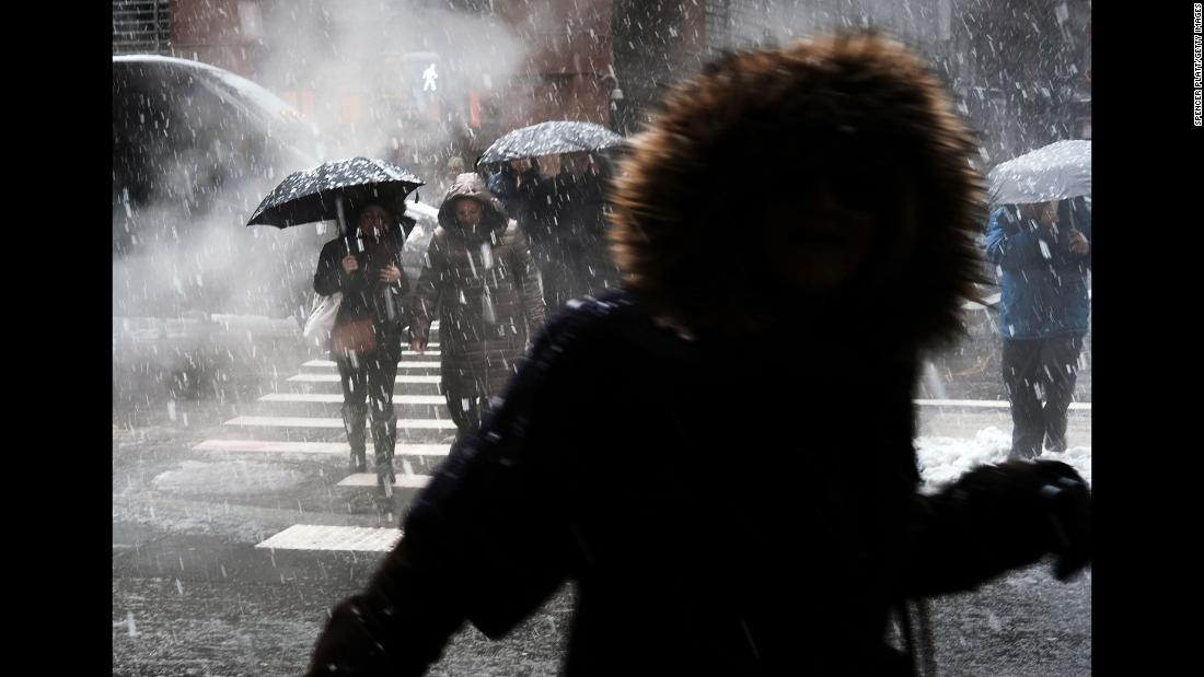 "Pedestrians walk through the <a href=""https://www.cnn.com/2018/03/21/politics/new-york-city-record-snow/index.html"" target=""_blank"">snow in Manhattan</a> on Wednesday, March 21, in New York City. The Big Apple and much of New England experienced a <a href=""https://www.cnn.com/2018/03/21/us/noreaster-storm/index.html"" target=""_blank"">fourth nor'easter in three weeks</a> that resulted in the cancellation of hundreds of flights, downed power lines and closed schools and businesses."