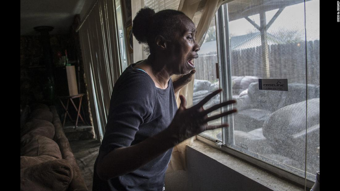 "In this photo from Tuesday, March 20, Sequita Thompson recounts the horror of seeing her grandson Stephon Clark dead in her backyard after he was <a href=""https://www.cnn.com/2018/03/22/us/sacramento-police-shooting/index.html"" target=""_blank"">shot by police</a> in Sacramento, California. Relatives, activists and Sacramento officials are questioning why police shot the unarmed man 20 times, killing him, when he turned out to be holding only a cellphone in his grandparents' backyard."