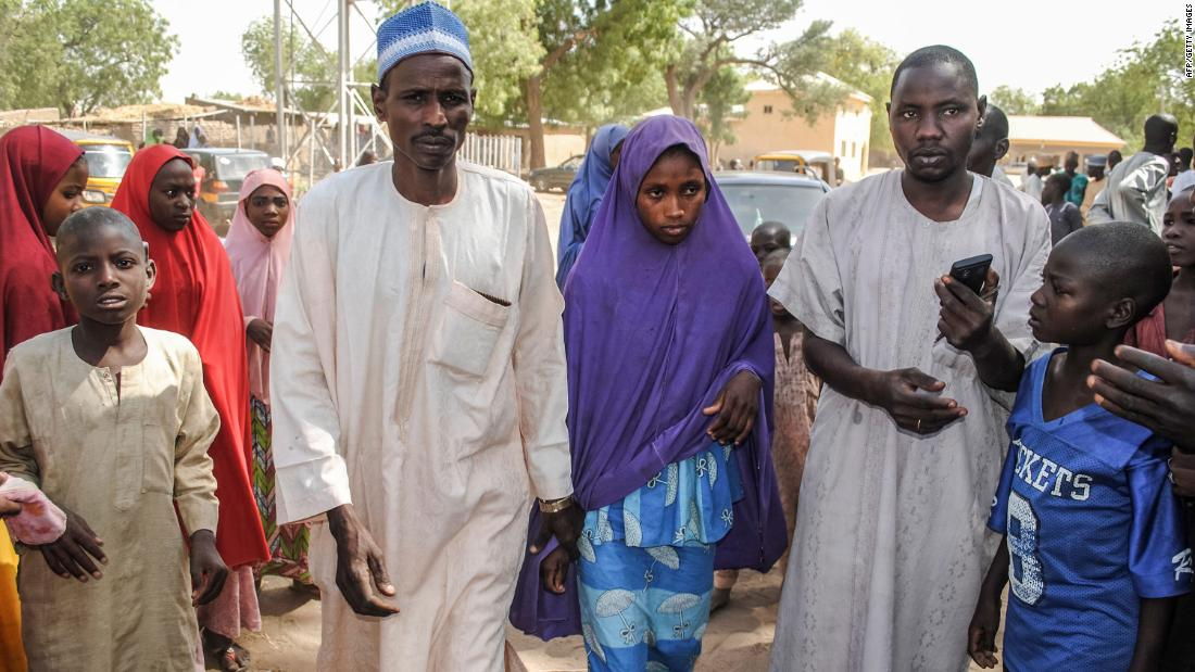 "A girl released by the terror group Boko Haram walks with her father in Dapchi, Nigeria, on Wednesday, March 21. Most of the 110 schoolgirls kidnapped last month in Nigeria by Boko Haram have been released and returned to their hometown of Dapchi, <a href=""https://www.cnn.com/2018/03/21/africa/nigeria-kidnapped-girls-boko-haram-intl/index.html"" target=""_blank"">a Nigerian minister said Wednesday</a>."